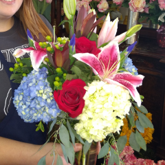 DiBella Flowers & Gifts Las Vegas - In celebration the I Heart Radio Celebration the I Heart You Bouquet! Blue and white hydrangea, Green Hypericum, Stargazers, and Roses in a cylinder glass vase.
