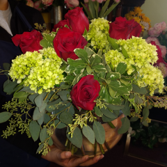 DiBella Flowers & Gifts Las Vegas - In Celebration of Life is Beautiful! Velvety red roses and fresh green hydrangeas in a bubble bowl.