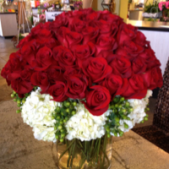 DiBella Flowers & Gifts Las Vegas - 100 roses, color of choice, with Hypericum and hydrangeas arranged in a cylinder vase