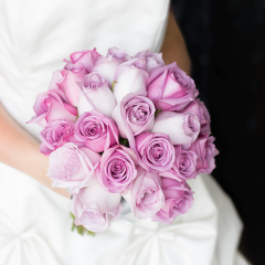"""DiBella Flowers & Gifts Las Vegas - Is there anything more romantic than roses? This bridal bouquet is designed with 24 gorgeous roses in shades of lavender in a traditional, dome shape. The bouquet is finished with a satin ribbon.  Select 'Bouquet Only' to purchase the bridal bouquet, or select 'w/ Boutonniere' to purchase the bridal bouquet and a matching boutonniere for the groom.  Bouquet is approximately 10"""" in diameter"""