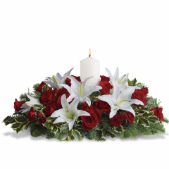 DiBella Flowers & Gifts Las Vegas - This luminous centerpiece is a glowing way to spread the joy of the season. Whether displayed on the dining table or placed elsewhere, it will light up any room with holiday cheer. **Oregonia a similar looking green may be substituted for the seasonally available holly.