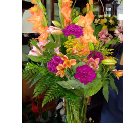DiBella Flowers & Gifts Las Vegas - Vivid oranges and purples!  Named after our equally as cheery, driver Sienna.