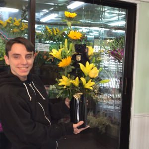DiBella Flowers & Gifts Las Vegas - Celebrating our Las Vegas Golden Knights! Golden hued roses, sunflowers and lilies with gold accents in a black cylinder and official Knights beanie included.