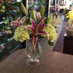DiBella Flowers & Gifts Las Vegas - Green hydrangea and pink stargazers in speckled silver pedestal vase.