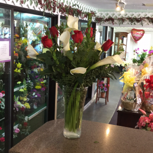 DiBella Flowers & Gifts Las Vegas - Bright white callas and long stemmed roses in flared glass vase. Beautiful!