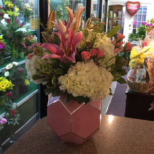 DiBella Flowers & Gifts Las Vegas - Bright pink and a fluffy whites in an art glass vase. Perfect for any occasion.