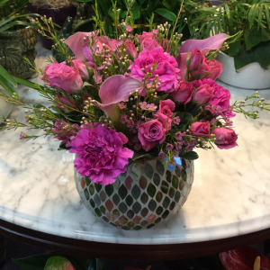 DiBella Flowers & Gifts Las Vegas - Purple mini callas, deep purple carbs and violet spray roses in a keepsake pastel mirrored vase. Named after the most sassiest, independent 3 year old little girl.