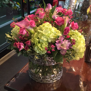 DiBella Flowers & Gifts Las Vegas - Perfect purples and green in a filigree vase. Chosen by our very own Rosil. ** The mini callas shown are available on a seasonal basis and may be substituted as needed.
