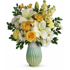 DiBella Flowers & Gifts Las Vegas - This colorful mix features yellow roses, white asiatic lilies, yellow alstroemeria, light yellow carnations, light yellow stock, white daisy spray chrysanthemums, white sinuata statice, and huckleberry. Delivered in an Art of Spring vase.