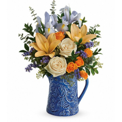 DiBella Flowers & Gifts Las Vegas - Pour on the spring charm with this beautiful blue and yellow bouquet, artfully arranged in a hand-glazed ceramic pitcher with an etched botanical design. Simply stunning!