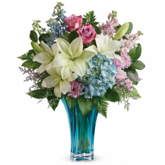 DiBella Flowers & Gifts Las Vegas - Her heart will dance when this breathtaking Mother's Day gift arrives! Bursting with blue and pink blooms, this enchanting azure vase is carefully crafted of blown glass in a stunning swirled design, it's a décor keepsake like no other.