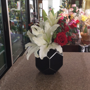 DiBella Flowers & Gifts Las Vegas - Count me lucky to have you in my life.  White Casablanca lilies, red roses and coffee bean in black Art Deco container