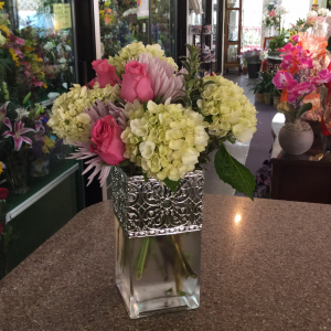 DiBella Flowers & Gifts Las Vegas - Be their favorite forever with this beautiful mix. Pink roses, lavender spider mums and green hydrangea in a cubed filigree vase.