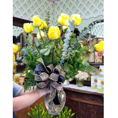 DiBella Flowers & Gifts Las Vegas - A dozen of our gorgeous extra large headed Colombian yellow roses with springs of golden ting ting and a black and gold ribbon in honor of our Vegas golden Knights. Go Knights!