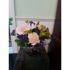 DiBella Flowers & Gifts Las Vegas - A beautiful light colored arrangement in a copper style round container.