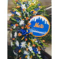 DiBella Flowers & Gifts Las Vegas - Remember your loved one with a logo of their favorite sports team in their color themed standing spray.