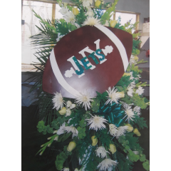 DiBella Flowers & Gifts Las Vegas - Celebrate your loved one with a custom standing spray to include their favorite football team.