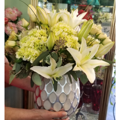 DiBella Flowers & Gifts Las Vegas - The Light bouquet features fresh lilies, full hydrangeas and delicate spray roses in a elegant silver and white keepsake vase.