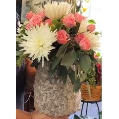 DiBella Flowers & Gifts Las Vegas - White spider mums, pink spray roses and fresh eucalyptus in this awesome stone decorated vase. Clear quartz amplifies energy and thought and absorbs, stores and releases bad mojo... so says google. Can be used as a candle holder later.