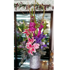 DiBella Flowers & Gifts Las Vegas - Named after our newest designer Karina! Vivid Gladiolus, Stargazers, Iris and a rose in a mercury glass vase. Bright and happy just like her =) Can be used as a candle holder after.