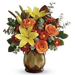 DiBella Flowers & Gifts Las Vegas - An unforgettable fall gift, the citrus hues of this fabulous fall bouquet look radiant atop an amber glass lantern that shimmers with golden leaves. Later, add a votive candle for a stunning autumnal glow!