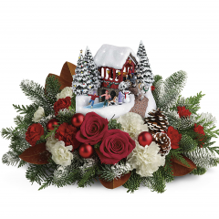 DiBella Flowers & Gifts Las Vegas - An instant Christmas classic, this festive arrangement of red roses and fresh winter greens accompanies a delightful, hand-painted Thomas Kinkade sculpture with light-up covered bridge.