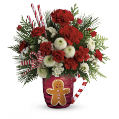 DiBella Flowers & Gifts Las Vegas - Cozy up to Christmas with this festive mix of winter greens and cheerful blooms, hand-delivered in a jolly gingerbread man mug for years of sipping pleasure!