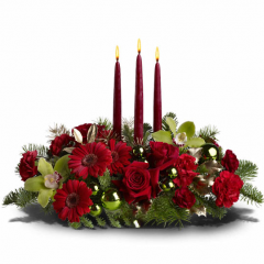 DiBella Flowers & Gifts Las Vegas - Are you dreaming of a bright Christmas? Then make this stylish centerpiece the center of your holiday festivities. A medley of red and green blooms - including roses and orchids - is arranged with ornaments and evergreens around three tall taper candles. Truly sensational!