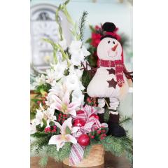 DiBella Flowers & Gifts Las Vegas - Adorable Keepsake Snowman figure in a basket bursting with seasonal Christmas blooms!