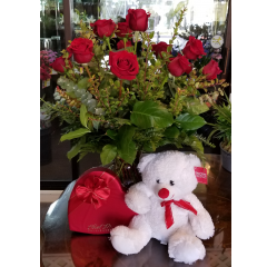 DiBella Flowers & Gifts Las Vegas - To My Valentine Package is everything you need to woo your Valentine this holiday. A dozen gorgeous long stemmed roses, and Satin Red Heart Box of Ethel M Chocolates and a fluffy white bear.