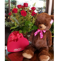 DiBella Flowers & Gifts Las Vegas - The Big Love Rose Package includes everything you need to WOW them this holiday. A Dozen gorgeous long stemmed roses, Large Box Satin Heart Ethel M Gourmet Chocolates and our Extra Large Brown Bear! * If no color is chosen, Red roses will be sent.