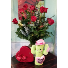 DiBella Flowers & Gifts Las Vegas - Stuck On You Rose Package Everything you need to woo your Valentine this holiday. A dozen gorgeous long stemmed roses, and Satin Red Heart Box of Ethel M Chocolates and an adorable Cactus plush.