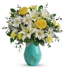 DiBella Flowers & Gifts Las Vegas - A dreamy surprise any day of the week! As radiant as a sunbeam in spring, this magnificent mix of yellow roses and white lilies looks perfect in this pretty ceramic vase with fresh aqua glaze and distressed raised details.
