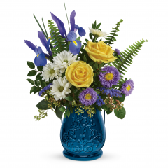 DiBella Flowers & Gifts Las Vegas - Stunning in sapphire, this glorious glass lantern is the perfect presentation for a beautiful bouquet of yellow roses and blue iris. Later, add a candle for a gorgeous glow!