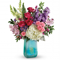 DiBella Flowers & Gifts Las Vegas - What a beauty! Shimmering with a glorious iridescent finish, this breathtaking, hand-blown art glass vase is a gift in and of itself. Filled with a chic bouquet of hydrangea and roses, it's a lavish spring surprise they'll remember forever!