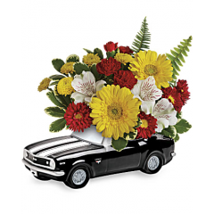 DiBella Flowers & Gifts Las Vegas - Get his motor running this Father's Day with this fun-filled flower gift! Red, yellow and white blooms burst from the back of of a '67 Chevy Camaro, a sleek ceramic keepsake that's just about as cool as he is!  This colorful arrangement includes miniature yellow gerberas, white alstroemeria, red miniature carnations, red matsumoto asters, yellow button spray chrysanthemums, variegated pittosporum and sword fern. Delivered in a '67 Chevy Camaro keepsake.