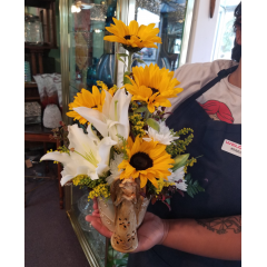 DiBella Flowers & Gifts Las Vegas - The Andria Bouquet with bright sunflowers and white lilies in a keepsake angel bouquet.  Made by our very own designer Andria!