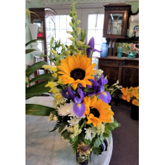 DiBella Flowers & Gifts Las Vegas - Fresh sunflowers, iris, snapdragons and more in a keepsake tall travel mug. *lid included