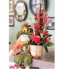 DiBella Flowers & Gifts Las Vegas - Fresh fall mix in keepsake scarecrow basket. Adorable!