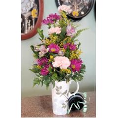 DiBella Flowers & Gifts Las Vegas - Pinks and purples in keepsake travel mug.