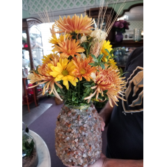 DiBella Flowers & Gifts Las Vegas - Our smokey quartz vase (also a candle holder) is full of fresh bronze and yellow blooms.  *Smoky quartz clears negative energies from the environment