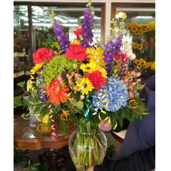 DiBella Flowers & Gifts Las Vegas - Bright fresh mix with curls of ribbon make this the perfect celebration bouquet!  All round and full of flowers!