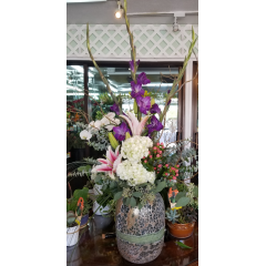 DiBella Flowers & Gifts Las Vegas - Hydrangea, Lilies, Gladiolus and fresh Coffee Bean in beautiful art glass vase.