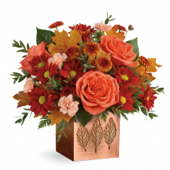 DiBella Flowers & Gifts Las Vegas - Capture the magic of fall with this seasonal rose bouquet, presented in a shimmering copper-plated cube with leaf-punched motif. Later, add a votive candle and let its autumnal style shine!