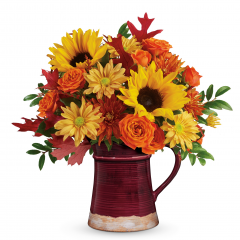 DiBella Flowers & Gifts Las Vegas - Bring the beauty of the outdoors in with this wildly wondrous bouquet of blooms, featuring the classic hues of autumn arranged in a hand-glazed, food-safe ceramic pitcher for years of enjoyment.
