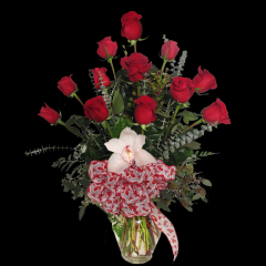 DiBella Flowers & Gifts Las Vegas - The perfect dozen! 12 of our premium roses, with a little Valentine's Day flare, to show your love.  *Orchid color may vary *Ribbon may vary Please specify color - Red will be sent if no color is chosen Pricing Good 2/1/20- 2/14/20