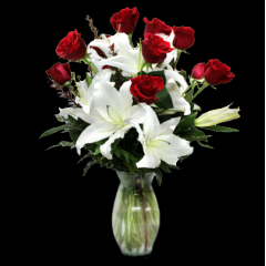 DiBella Flowers & Gifts Las Vegas - One dozen of our premium roses with lush stems of white stargazer lilies. An elegant way to show your love. Please specify color - Red will be sent if no color is chosen