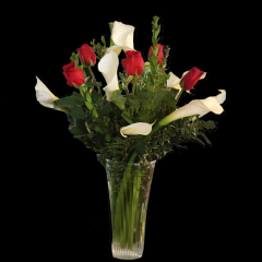 DiBella Flowers & Gifts Las Vegas - Bright white callas and long stemmed roses in flared glass vase. Beautiful! * Valentines pricing may vary