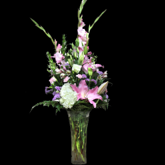DiBella Flowers & Gifts Las Vegas - Pink Glamour Bouquet Lush pink blooms in a trumpet vase is a perfect way to show that special someone that you care. Hydrangea, Lilies, Lisianthus Gladiolus and more are arranged in a art-deco vase.
