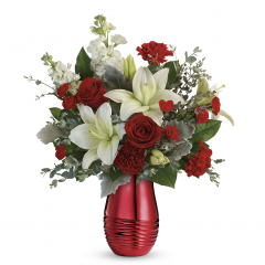 "DiBella Flowers & Gifts Las Vegas - Red roses, white asiatic lilies, red carnations, red miniature carnations, and white stock are arranged with, eucalyptus, and lemon leaf. Delivered in a Radiantly Rouge Vase. Approximately 17 1/2"" W x 20 1/2"" H"